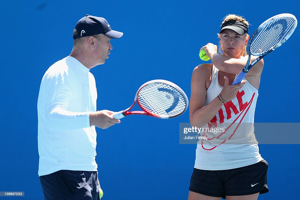 Maria Sharapova of Russia and coach Thomas Hogstedt chat in a practice session during day ten of the 2013 Australian Open at Melbourne Park on January 23, 2013 in Melbourne, Australia.