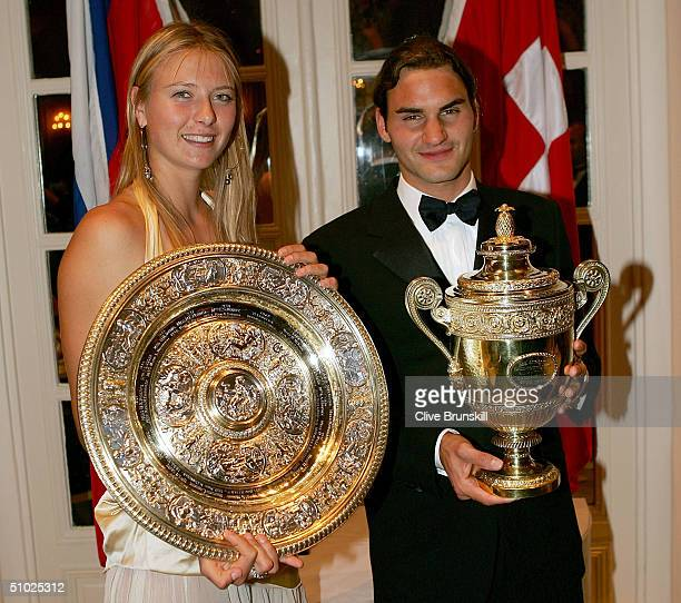 Maria Sharapova of Russia and Roger Federer of Switzerland pose for photographs at the Wimbledon Champions Dinner at the Savoy Hotel on July 4 2004...