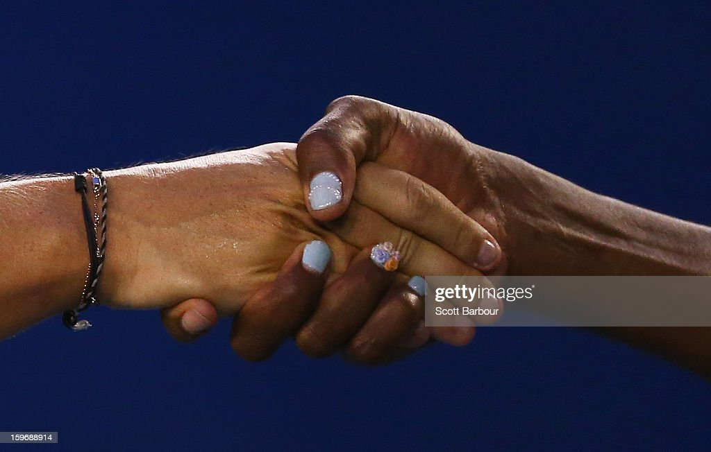 Maria Sharapova of Russia and Venus Williams of the United States shake hands at the conclusion of their third round match during day five of the 2013 Australian Open at Melbourne Park on January 18, 2013 in Melbourne, Australia.