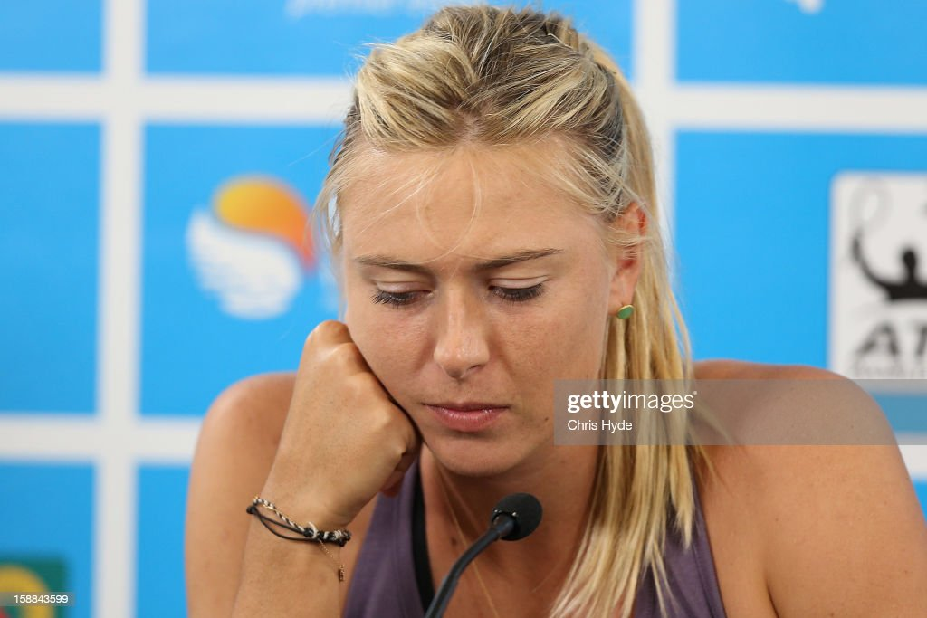 <a gi-track='captionPersonalityLinkClicked' href=/galleries/search?phrase=Maria+Sharapova&family=editorial&specificpeople=157600 ng-click='$event.stopPropagation()'>Maria Sharapova</a> of Russia announces her withdrawal from the tournament on day three of the Brisbane International at Pat Rafter Arena on January 1, 2013 in Brisbane, Australia.