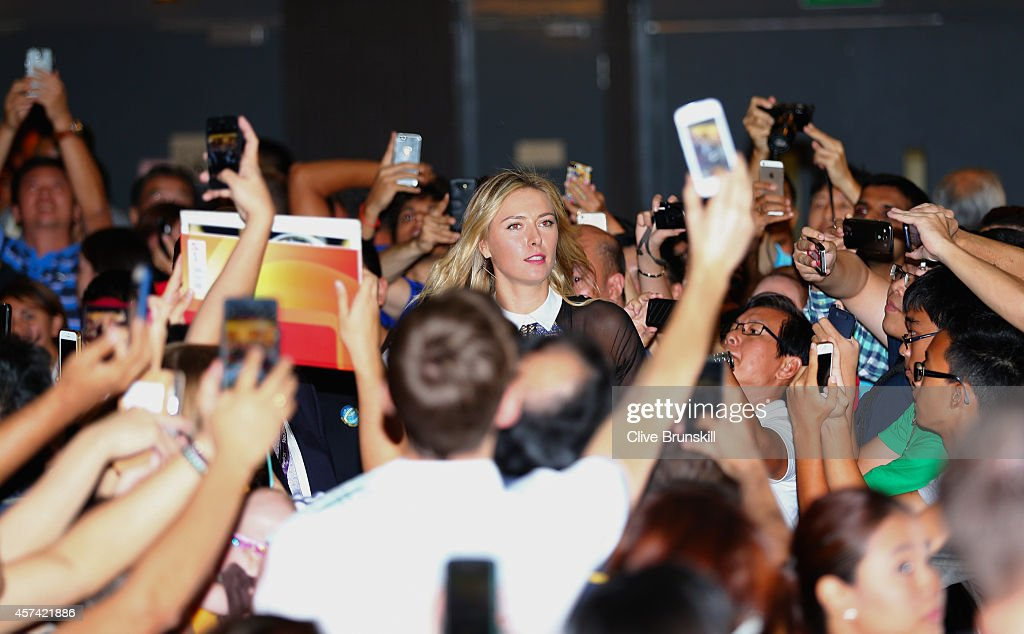 Maria Sharapova of Russia arrives at the Marina Bay Sands shopping centre for the draw ceremony prior to the start of the BNP Paribas WTA Finals at Singapore Sports Hub on October 18, 2014 in Singapore.