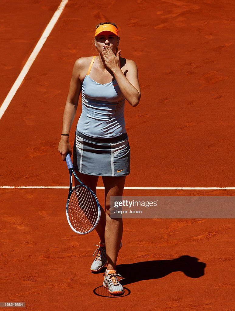 <a gi-track='captionPersonalityLinkClicked' href=/galleries/search?phrase=Maria+Sharapova&family=editorial&specificpeople=157600 ng-click='$event.stopPropagation()'>Maria Sharapova</a> of Russia blows a handkiss to her fans celebrating matchpoint over Ana Ivanovic of Serbia after winning her semi-final match on day eight of the Mutua Madrid Open tennis tournament at the Caja Magica on May 11, 2013 in Madrid, Spain.