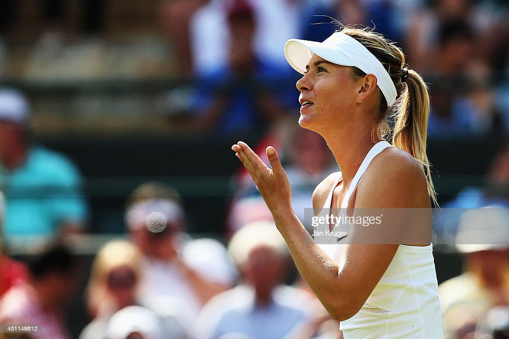 Maria Sharapova of Russia blows a kiss to the fans after winning her Ladies' Singles first round match against against Samantha Murray of Great Britain on day two of the Wimbledon Lawn Tennis Championships at the All England Lawn Tennis and Croquet Club at Wimbledon on June 24, 2014 in London, England.