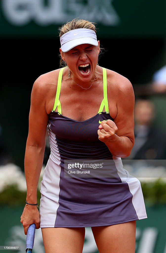 Maria Sharapova of Russia celebrates a point in her womens' singles semi-final match against Victoria Azarenka of Belarus against during day twelve of the French Open at Roland Garros on June 6, 2013 in Paris, France.