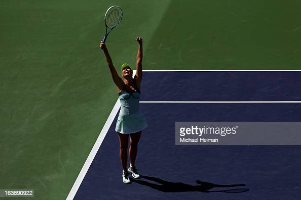 Maria Sharapova of Russia celebrates after defeating Caroline Wozniacki of Denmark in straight sets to win the women's final match of the 2013 BNP...