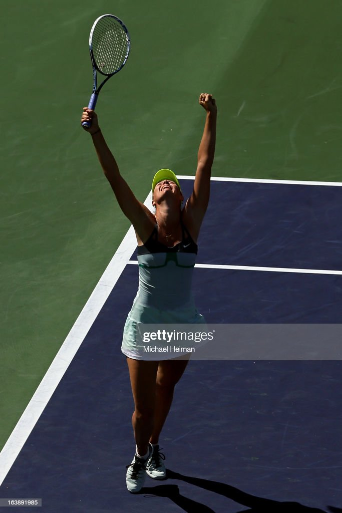 <a gi-track='captionPersonalityLinkClicked' href=/galleries/search?phrase=Maria+Sharapova&family=editorial&specificpeople=157600 ng-click='$event.stopPropagation()'>Maria Sharapova</a> of Russia celebrates after defeating Caroline Wozniacki of Denmark in straight sets to win the women's final match of the 2013 BNP Paribas Open at the Indian Wells Tennis Garden on March 17, 2013 in Indian Wells, California.