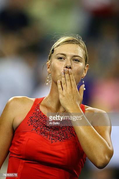 Maria Sharapova of Russia celebrates after defeating Roberta Vinci of Italy during day two of the 2007 US Open at the Billie Jean King National...