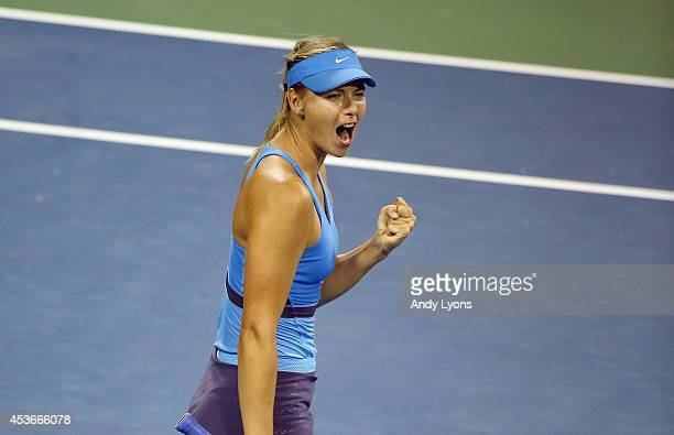 Maria Sharapova of Russia celebrates after defeating Simona Halep of Romania after a match on Day 7 of the Western Southern Open on August 15 2014 at...