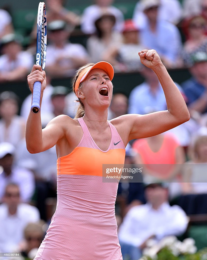 Maria Sharapova of Russia celebrates after winning the final match of the French Open tennis tournament against Simona Halep of Romania at Roland Garros Stadium in Paris, France on June 7, 2014