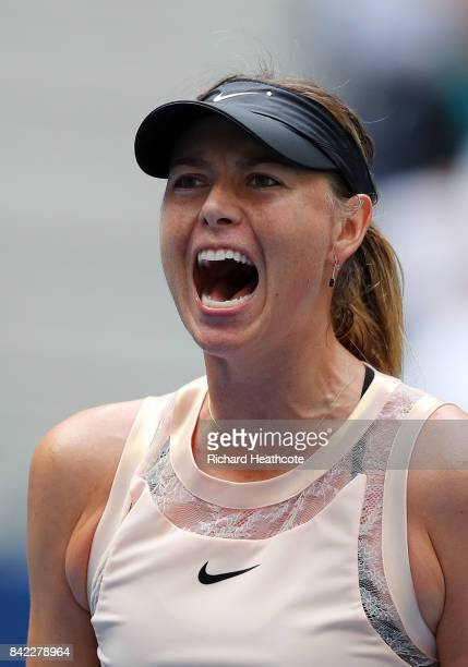 Maria Sharapova of Russia celebrates after winning the first set of her women's singles fourth round match against Anastasija Sevastova of Latvia on...