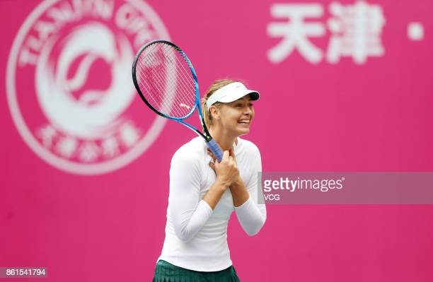 Maria Sharapova of Russia celebrates after winning the women's singles final match against Aryna Sabalenka of Belarus at the WTA Tianjin Open tennis...