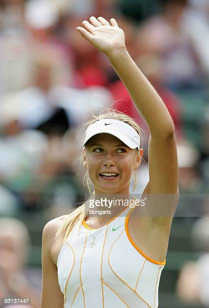 Maria Sharapova of Russia celebrates defeating Sesil Karatancheva of Bulgaria during the fourth day of the Wimbledon Lawn Tennis Championship on June...