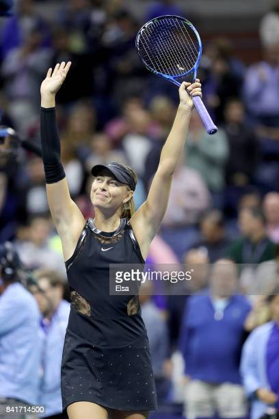Maria Sharapova of Russia celebrates her match win over Sofia Kenin of the United States during their third round Women's Singles match on Day Five...