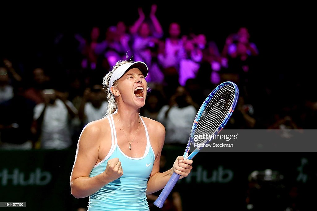 <a gi-track='captionPersonalityLinkClicked' href=/galleries/search?phrase=Maria+Sharapova&family=editorial&specificpeople=157600 ng-click='$event.stopPropagation()'>Maria Sharapova</a> of Russia celebrates her win against Simona Halep of Romania in a round robin match during the BNP Paribas WTA Finals at Singapore Sports Hub on October 27, 2015 in Singapore.