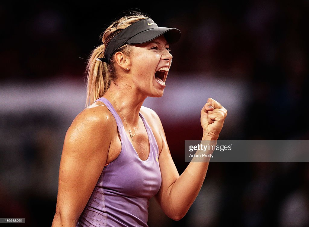 <a gi-track='captionPersonalityLinkClicked' href=/galleries/search?phrase=Maria+Sharapova&family=editorial&specificpeople=157600 ng-click='$event.stopPropagation()'>Maria Sharapova</a> of Russia celebrates match point after her match against Agnieszka Radwanska of Poland on day five of the Porsche Tennis Grand Prix at Porsche Arena on April 25, 2014 in Stuttgart, Germany.