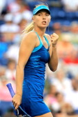 Maria Sharapova of Russia celebrates match point against Maria Kirilenko of Russia during the BNP Paribas Open at the Indian Wells Tennis Garden on...