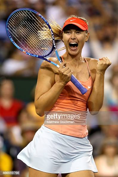 Maria Sharapova of Russia celebrates match point against Victoria Azarenka of Belarus during day eight of the BNP Paribas Open at the Indian Wells...