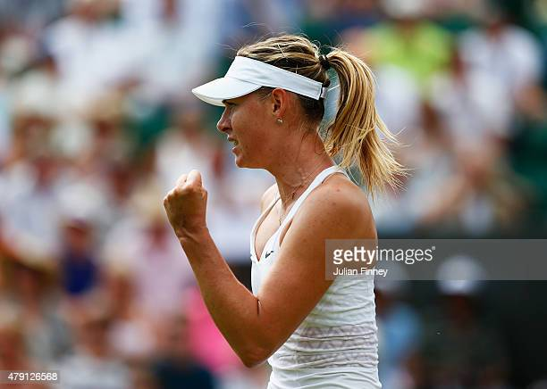 Maria Sharapova of Russia celebrates match point in her Ladies Singles Second Round match against Robin Haase of Netherlands during day three of the...