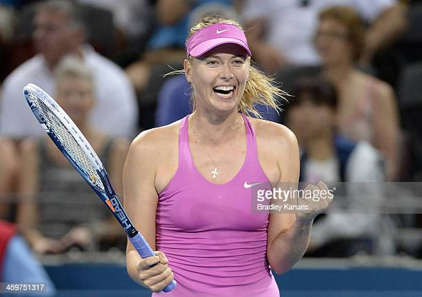 Maria Sharapova of Russia celebrates victory after winning her match against Caroline Garcia of France during day two of the 2014 Brisbane...
