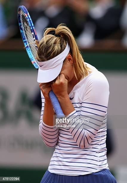 Maria Sharapova of Russia celebrates victory in her Women's Singles match against Samantha Stosur of Australia on day six of the 2015 French Open at...