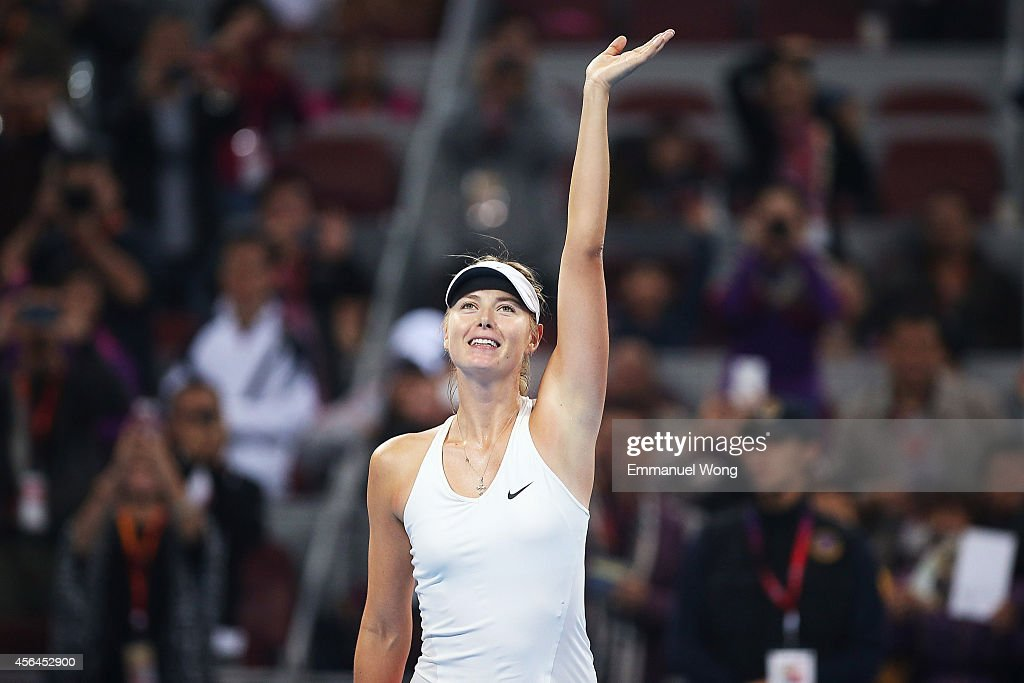 Maria Sharapova of Russia celebrates winning against Caria Suarez Navarro of the Spain during day five of the China Open at the China National Tennis Center on October 1, 2014 in Beijing, China.