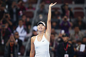 Maria Sharapova of Russia celebrates winning against Caria Suarez Navarro of the Spain during day five of the China Open at the China National Tennis...