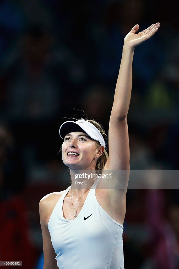 Maria Sharapova of Russia celebrates winning against Carla Suarez Navarro of Spain during day five of the China Open at the China National Tennis Center on October 1, 2014 in Beijing, China.