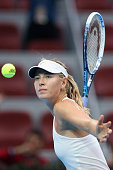 Maria Sharapova of Russia celebrates winning against Kaia Kanepi of Estonia during day two of the China Open at the China National Tennis Center on...