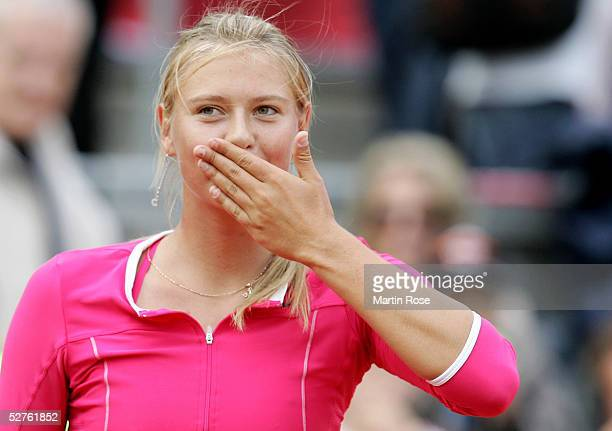 Maria Sharapova of Russia celebrates winning against Shuai Peng of China during the Qatar Total German Open on May 5 2005 in Berlin Germany