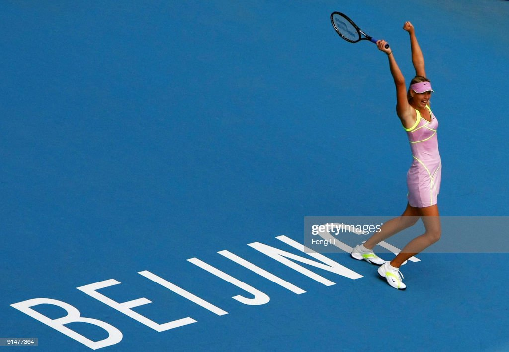Maria Sharapova of Russia celebrates winning against Victoria Azarenka of Belarus in her first round match during day five of the 2009 China Open at the National Tennis Centre on October 6, 2009 in Beijing, China.