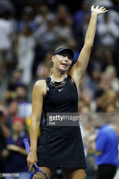 Maria Sharapova of Russia celebrates winning her first round Women's Singles match against Simona Halep of Romania on Day One of the 2017 US Open at...