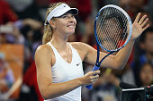 Maria Sharapova of Russia celebrates winning her match against Ana Ivanovic of Serbia during day eight of the China Open at the China National Tennis...