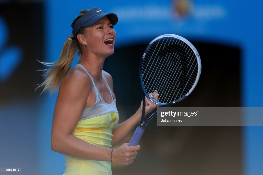 <a gi-track='captionPersonalityLinkClicked' href=/galleries/search?phrase=Maria+Sharapova&family=editorial&specificpeople=157600 ng-click='$event.stopPropagation()'>Maria Sharapova</a> of Russia celebrates winning her Quarterfinal match against Ekaterina Makarova of Russia during day nine of the 2013 Australian Open at Melbourne Park on January 22, 2013 in Melbourne, Australia.