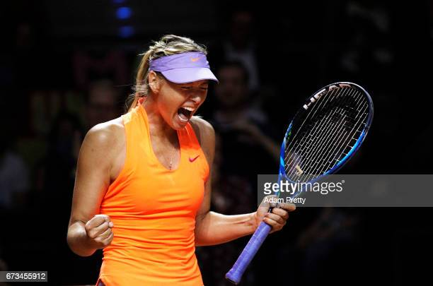 Maria Sharapova of Russia celebrates winning match point against Roberta Vinci of Italy during the Porsche Tennis Grand Prix at Porsche Arena on...