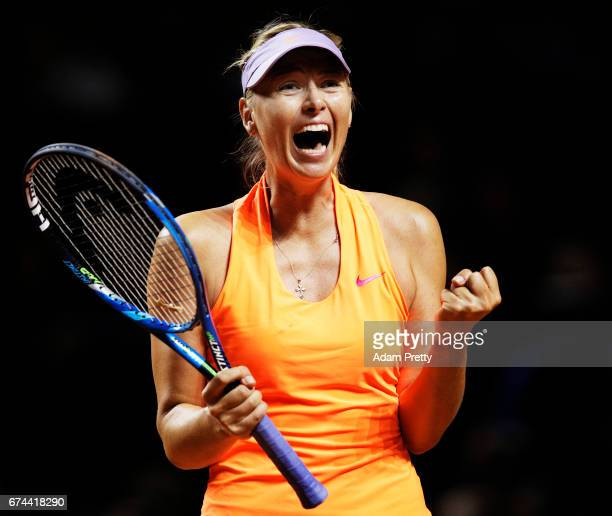 Maria Sharapova of Russia celebrates winning match point in match against Anett Kontaveit of Estonia during the Porsche Tennis Grand Prix at Porsche...