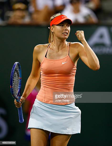 Maria Sharapova of Russia celebrates winning the first set against Victoria Azarenka of Belarus during day eight of the BNP Paribas Open tennis at...