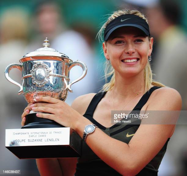 Maria Sharapova of Russia celebrates with the Coupe Suzanne Lenglen after the women's singles final against Sara Errani of Italy during day 14 of the...