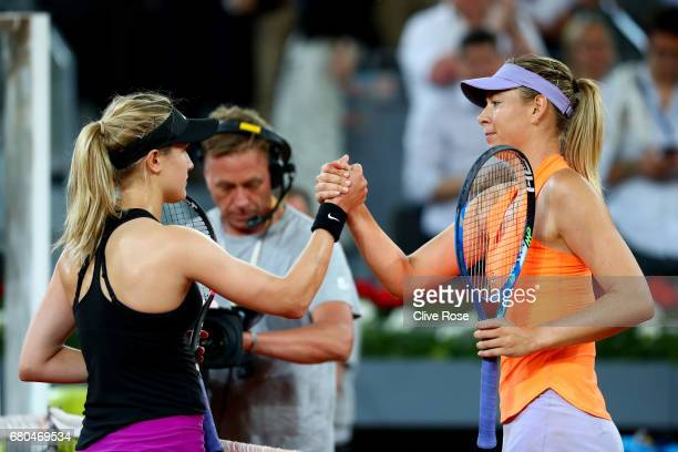Maria Sharapova of Russia congratulates Eugenie Bouchard of Canada at the end of the match on day three of the Mutua Madrid Open tennis at La Caja...