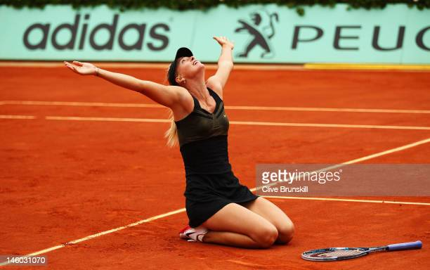 Maria Sharapova of Russia falls to her knees as she celebrates match point in the women's singles final against Sara Errani of Italy during day 14 of...