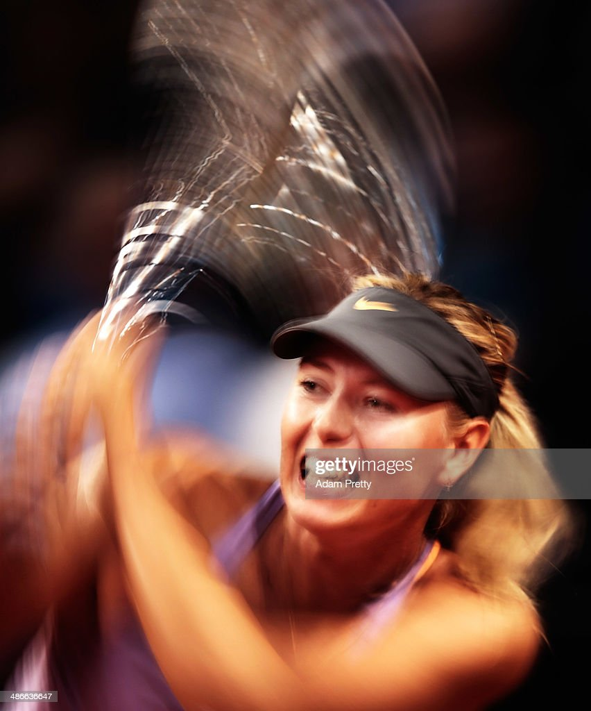 Maria Sharapova of Russia hits a backhand during her match against Agnieszka Radwanska of Poland on day five of the Porsche Tennis Grand Prix at Porsche Arena on April 25, 2014 in Stuttgart, Germany.