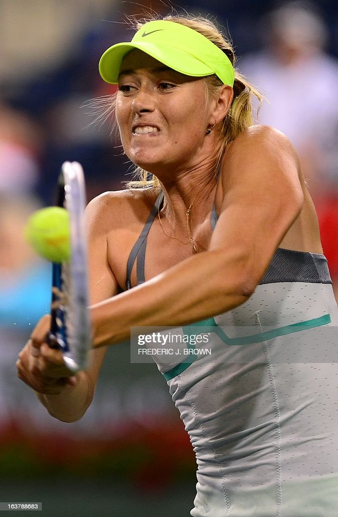 Maria Sharapova of Russia hits a backhand return against compatriot Maria Kirilenko on March 15, 2013 in Indian Wells, California, during their semi-final match at the BNP Paribas Open. AFP PHOTO / Frederic J. BROWN