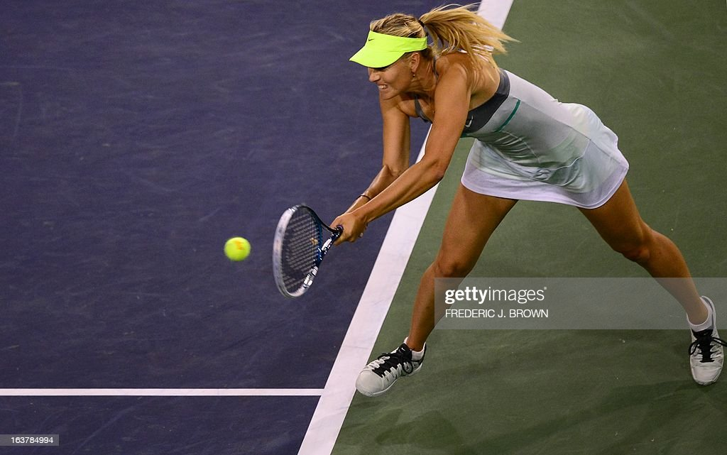 Maria Sharapova of Russia hits a backhand return from the baseline against compatriot Maria Kirilenko on March 15, 2013 in Indian Wells, California, during their semirfinal match at the BNP Paribas Open. AFP PHOTO/Frederic J. BROWN