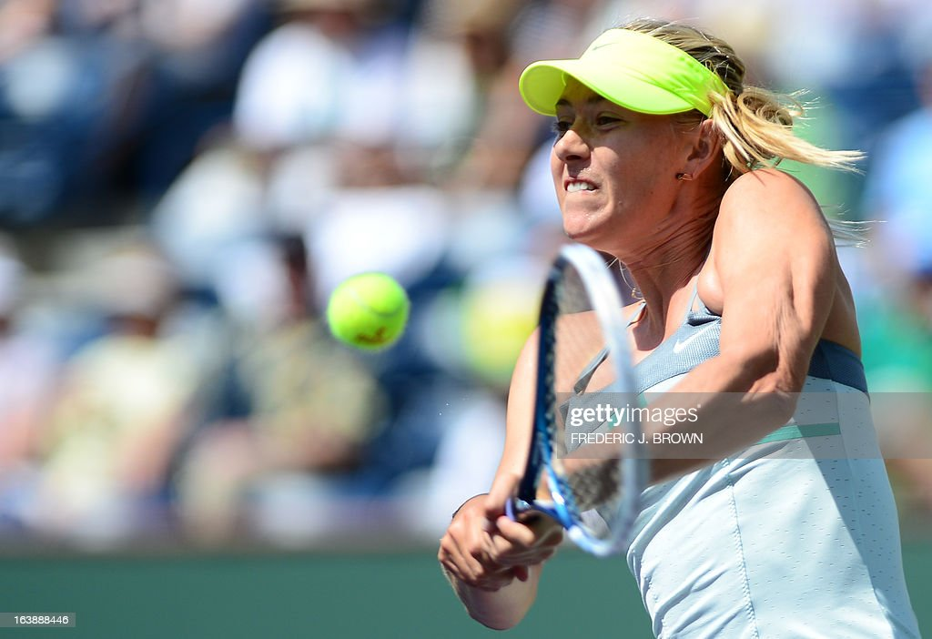 Maria Sharapova of Russia hits a backhand return to Caroline Wozniacki of Denmark on March 17, 2013 in Indian Wells, California, during the women's BNP Paribas Open final. AFP PHOTO/Frederic J. BROWN