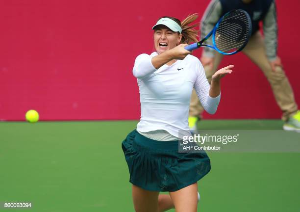 Maria Sharapova of Russia hits a return against IrinaCamelia Begu of Romania during their women's singles first round match at the WTA Tianjin Open...