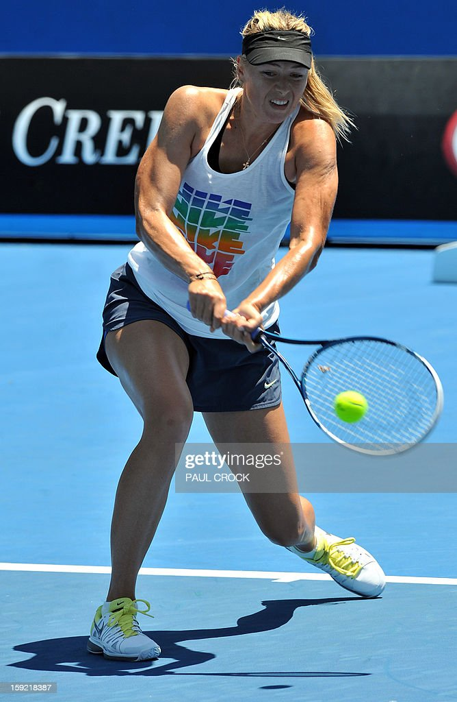 Maria Sharapova of Russia hits a return during a practice session for the upcoming Australian Open tennis tournament in Melbourne on January 10, 2013. The first Grand Slam tennis tournament of the year is set to run from January 14 to 27. AFP PHOTO / Paul CROCK IMAGE