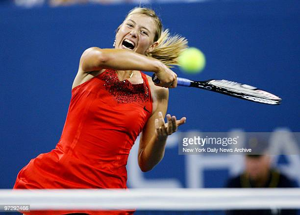 Maria Sharapova of Russia hits a return shot during her 2007 US Open match against Casey Dellacqua of Australia in Arthur Ashe Stadium at the Billie...