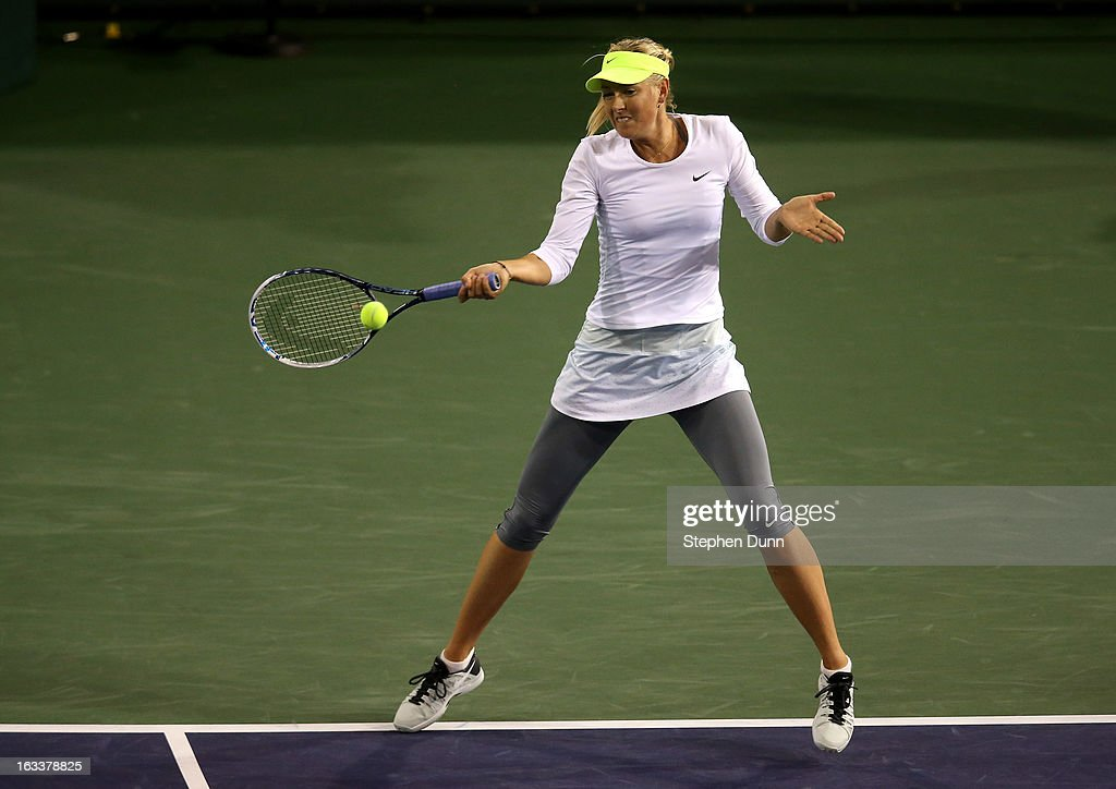 <a gi-track='captionPersonalityLinkClicked' href=/galleries/search?phrase=Maria+Sharapova&family=editorial&specificpeople=157600 ng-click='$event.stopPropagation()'>Maria Sharapova</a> of Russia hits a return to Francesca Schiavone of Italy during day 3 of the BNP Paribas Open at Indian Wells Tennis Garden on March 8, 2013 in Indian Wells, California.