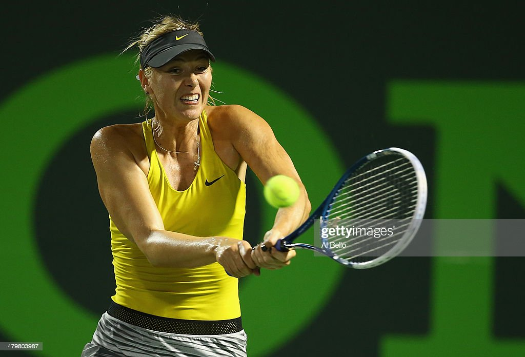 Maria Sharapova of Russia hits the ball against Kurumi Nara of Japan during their match on day 4 of the Sony Open at Crandon Park Tennis Center on March 20, 2014 in Key Biscayne, Florida.