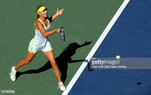 Maria Sharapova of Russia hits the ball to Sania Mirza of India in a fourthround match at Arthur Ashe Stadium during the US Open at Flushing...