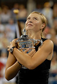 Maria Sharapova of Russia holds the championship trophy after her straight set victory over Justine HeninHardene of Belgium in the final of the US...
